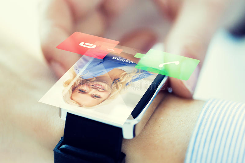 Close up of hand with incoming call on smart watch. Business, communication, technology and people concept - close up of women hands setting smart watch with royalty free stock images
