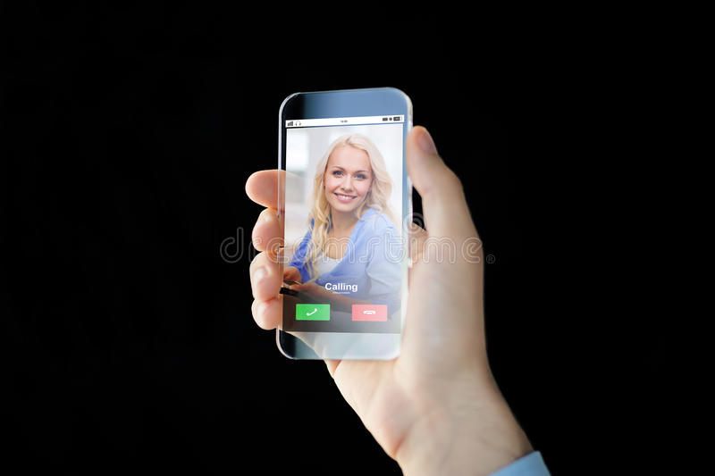 Close up of hand with incoming call on smartphone. Business, future technology and people concept - close up of male hand holding and showing transparent royalty free stock photos