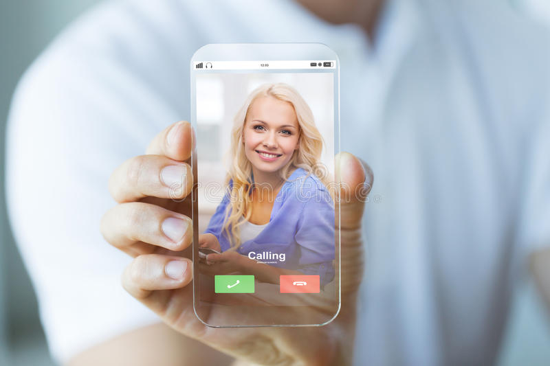 Close up of hand with incoming call on smartphone. Business, future technology and people concept - close up of male hand holding and showing transparent stock photos