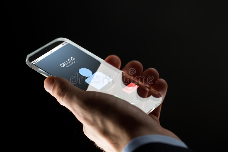 Close up of hand with incoming call on smartphone. Business, people and future technology concept - close up of businessman hand with incoming call on royalty free stock images