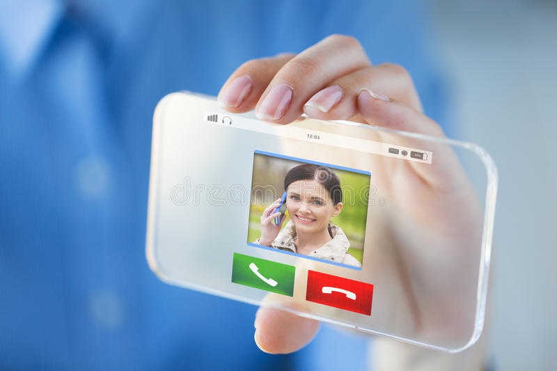 Close up of hand with incoming call on smartphone. Business, technology, communication and people concept - close up of women hand holding and showing incoming stock photography