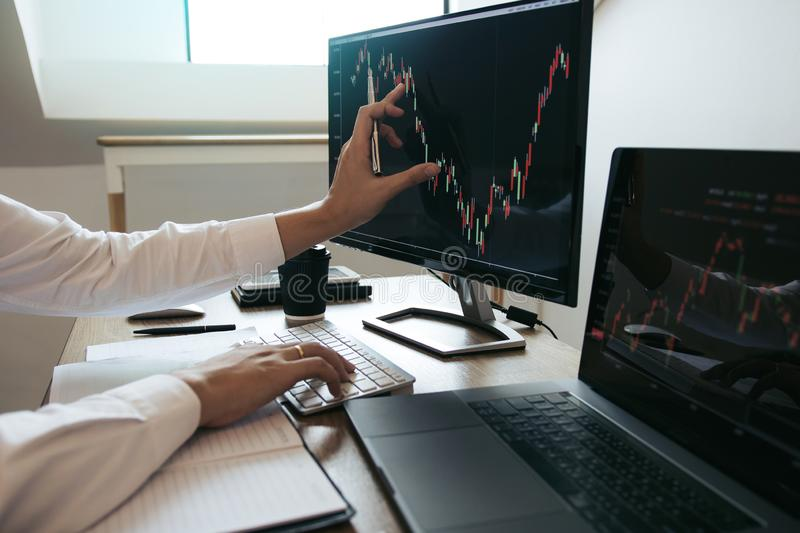 Close up of hand investors are pointing to laptop computer that have investment information stock markets and partners taking. Notes and analyzing performance royalty free stock photography