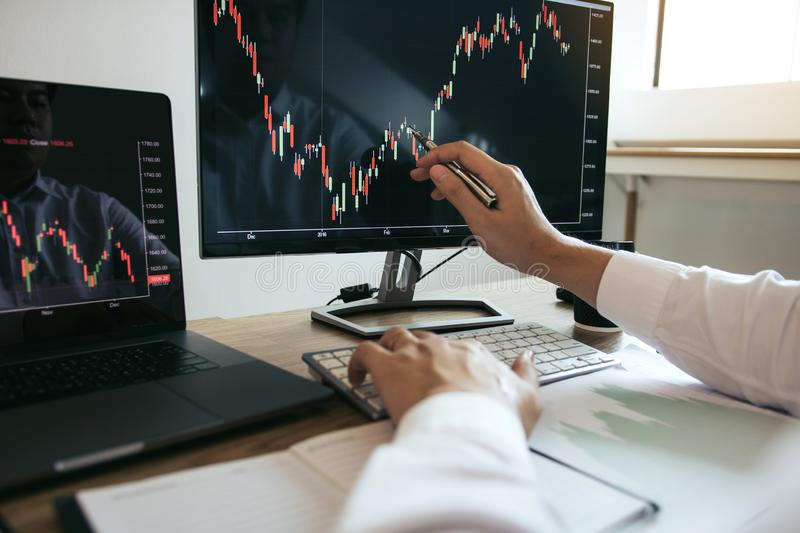 Close up of hand investors are pointing to laptop computer that have investment information stock markets and partners taking stock photography
