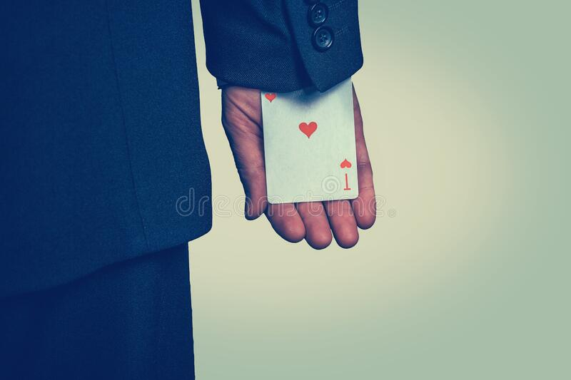 Male hand hiding ace card in the sleeve stock images