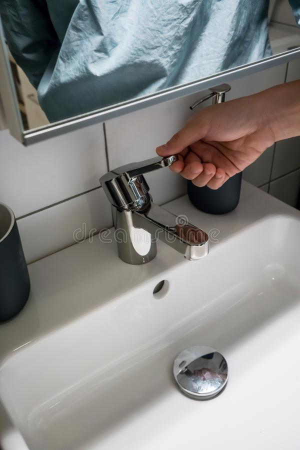 Close up hand open or close water tap. faucet stock photography