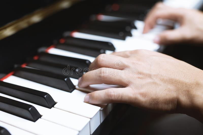 Close up of hand people man musician playing piano royalty free stock photos