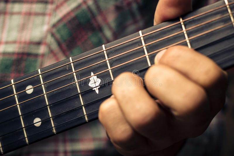Close Up On Hand Playing Guitar Royalty Free Stock Photos