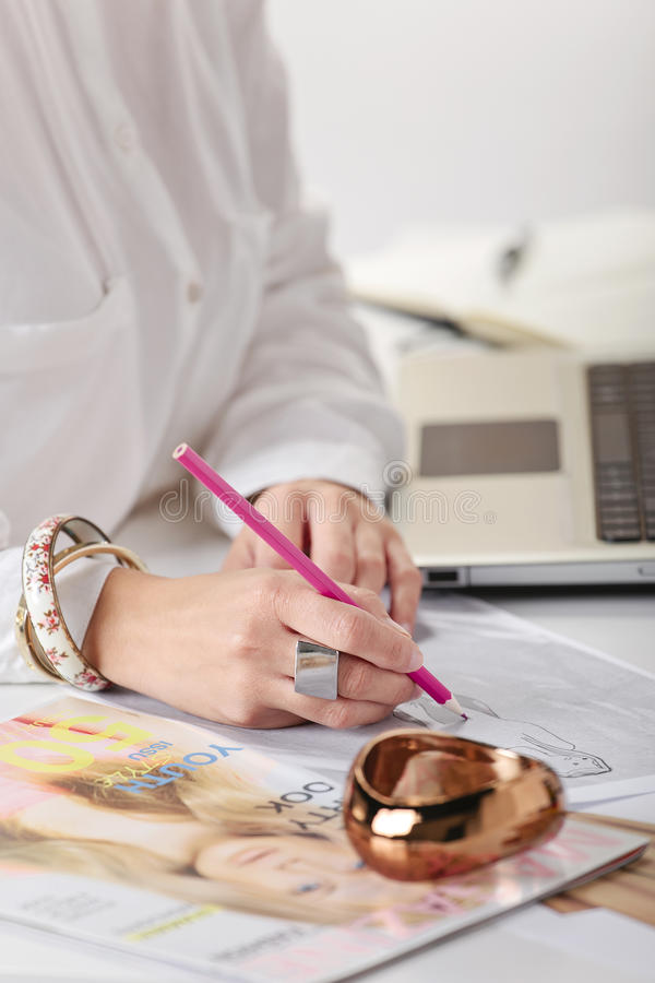 Download Close Up Of A Hand's Woman Doing Fashion Sketches. Stock Image - Image: 34467595
