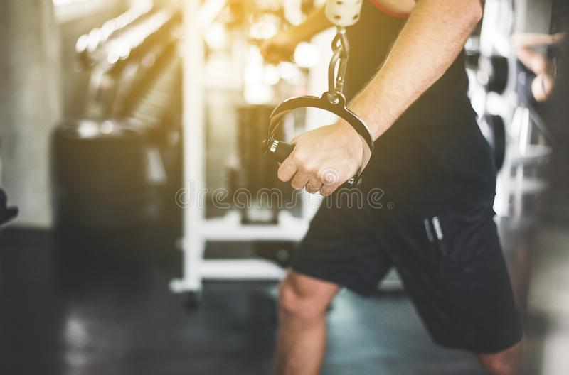 Close up of hand sport man doing exercises training,Cross fit body and muscular in the gym stock image