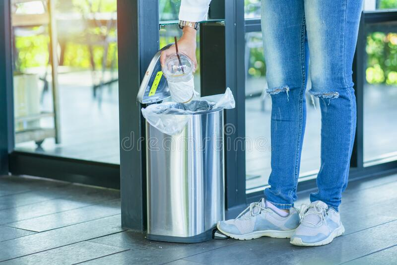 Close Up hand throwing empty litter in recycling bin royalty free stock photo