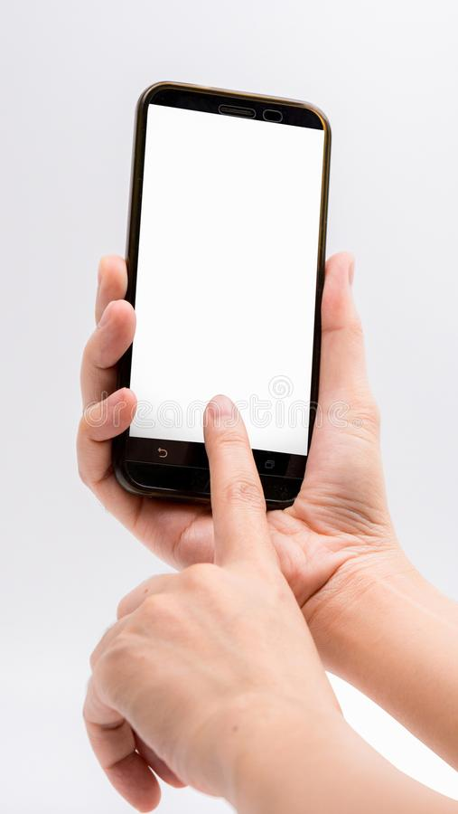Close-up hand touching smartphone screen isolated on white stock images