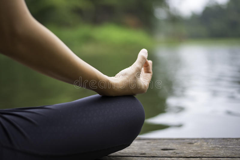 Close up hand. Woman do yoda outdoor. Woman exercising yoga royalty free stock photography