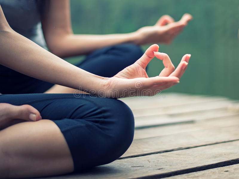 Close up hand. Woman do yoga outdoor royalty free stock images