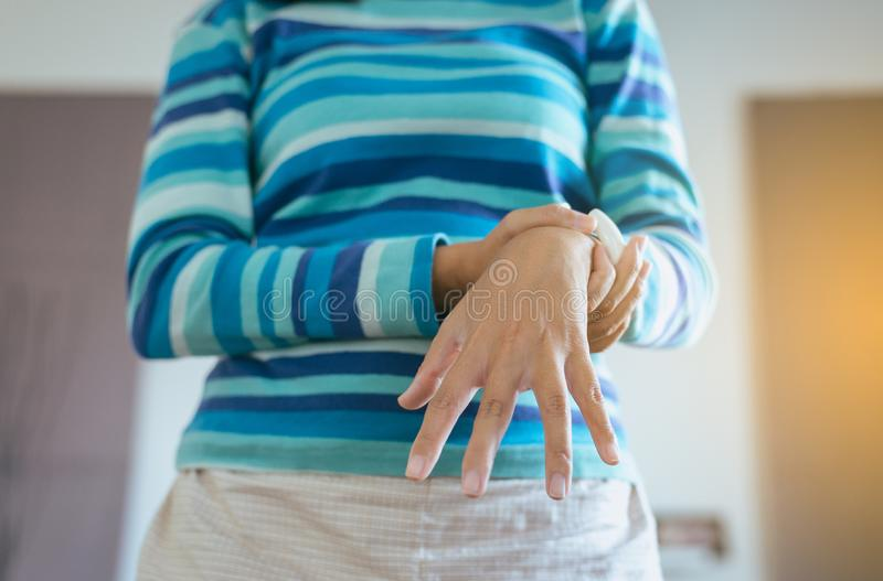 Close up of hand woman suffering with Parkinson disease symptoms,Female patient with shaking hand stock images