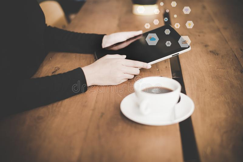 Close up hand woman use laptop and smartphone for connection internet of things. Business women use social network for business li royalty free stock photography