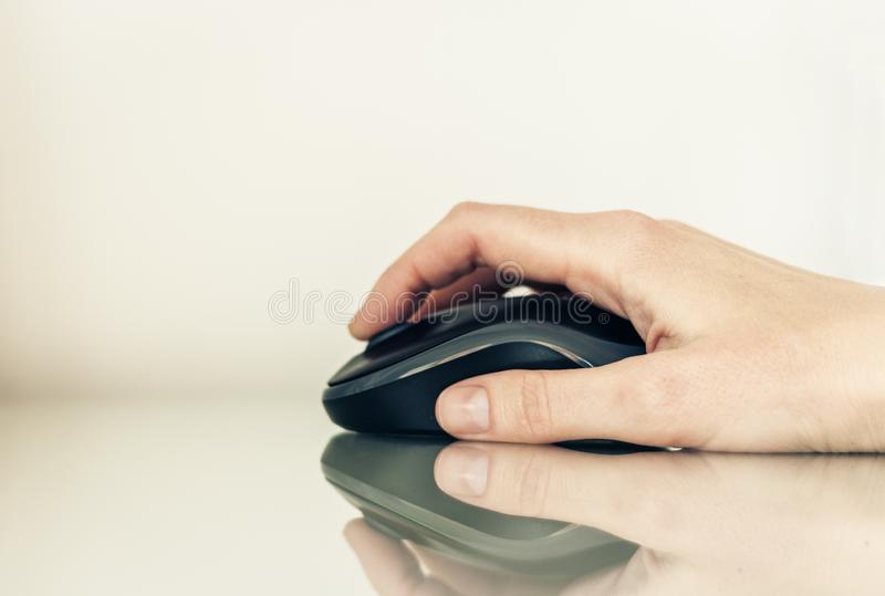Close-up of hand woman using a computer mouse on glass table, business concept royalty free stock photos