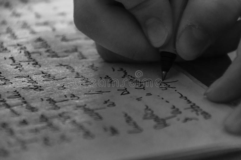 Close-Up Of Hand Writing On Paper royalty free stock photos