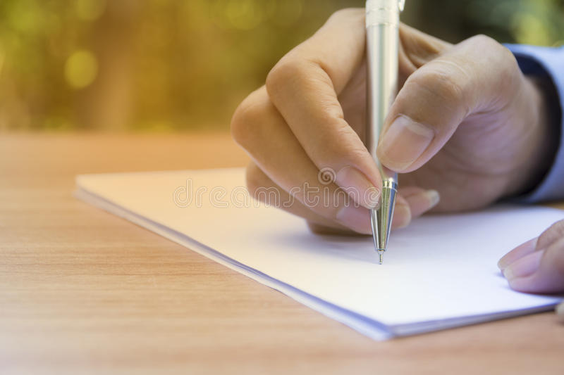 Close up hand writing on paper. Close up people writing royalty free stock photography