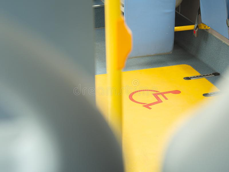 Close-up handicap logo in a bus. Priority seat for disabled people. Wheelchair accessible transportation concept stock photos