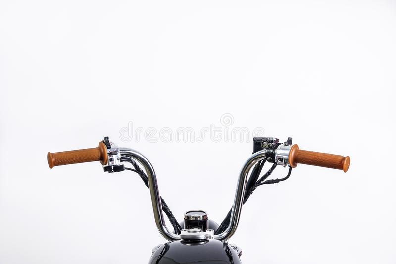 Close up of handlebar on vintage motorcycle. Custom scrambler /. Chopper. Retro motorbike on white background. Blank copy space for text royalty free stock image