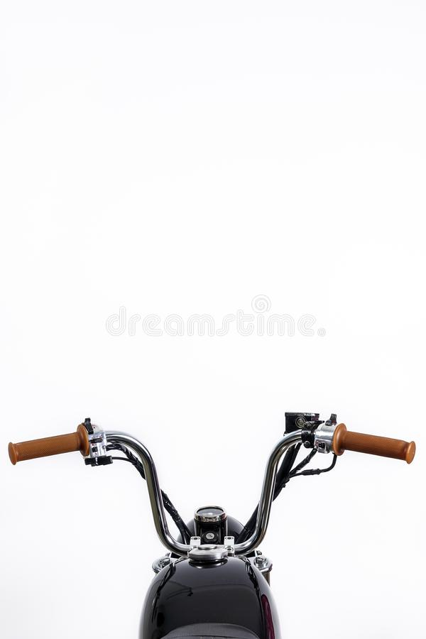 Close up of handlebar on vintage motorcycle. Custom scrambler /. Chopper. Retro motorbike on white background. Blank copy space for text royalty free stock photo