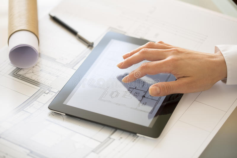 Close-up Of Hands Architect Woman Using Tablet Pc stock photo
