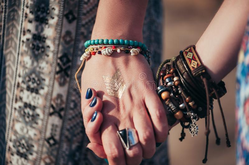 Close up hands with boho accessories royalty free stock images