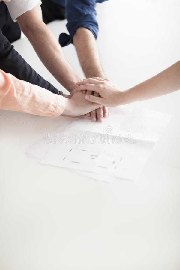 Close up of hands of business people on top of each other in partnership royalty free stock images
