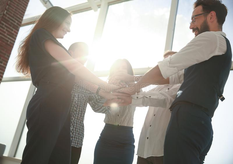 Close-Up of hands business team showing unity with putting their hands togethe royalty free stock photo