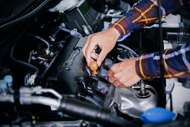 Close up hands checking lube oil level of car engine from deep-s stock images