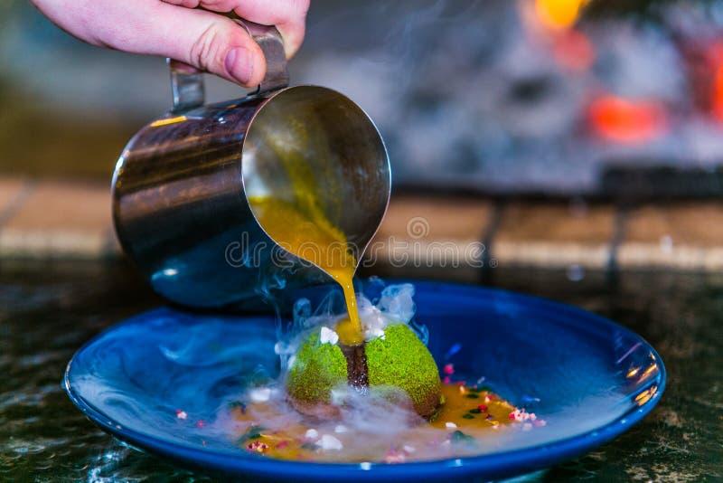 Close up hands of chef preparing sweet dezert royalty free stock image