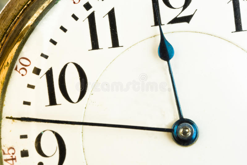 Close-up of hands on clock face stock photography