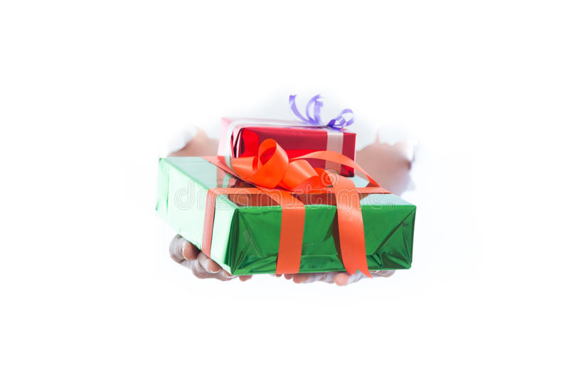 Close up of hands hold green gift box isolated on white background stock photo
