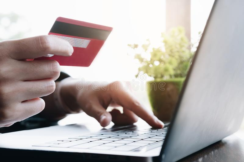 Close up.Hands holding credit card and using laptop. Online shopping stock photos