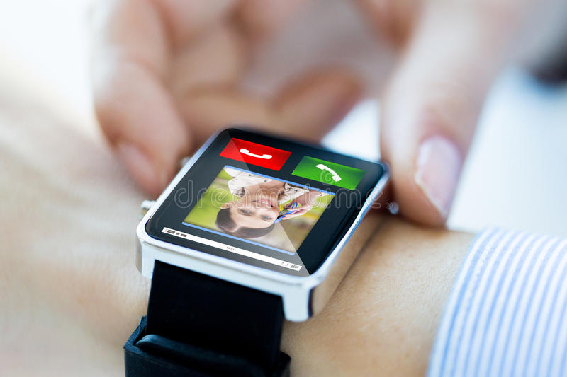 Close up of hands with incoming call on smartwatch. Business, technology, communication, connection and people concept - close up of women hands with incoming royalty free stock photography