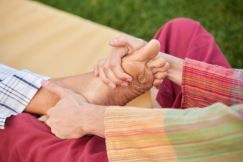 Close up hands massaging foot. stock image