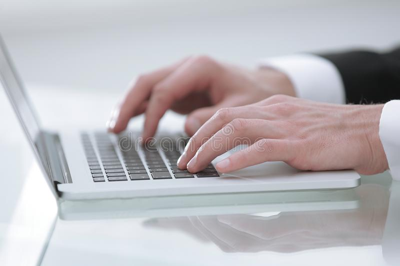 Close up hands multitasking man using laptop connecting wifi. Photo with copy space royalty free stock images