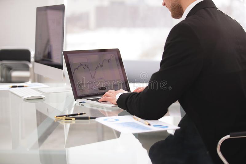 Close up hands multitasking man using laptop connecting wifi. Photo with copy space stock photo