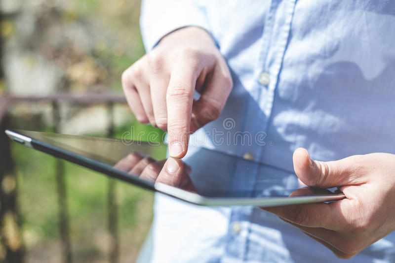 Close up hands multitasking man using tablet. Connecting wifi stock photos