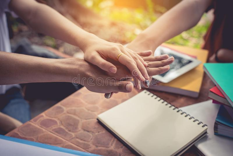 Close up hands of people putting and stacking their hands together. Friendship and Unity concept. Teamwork and Successful concept stock photo