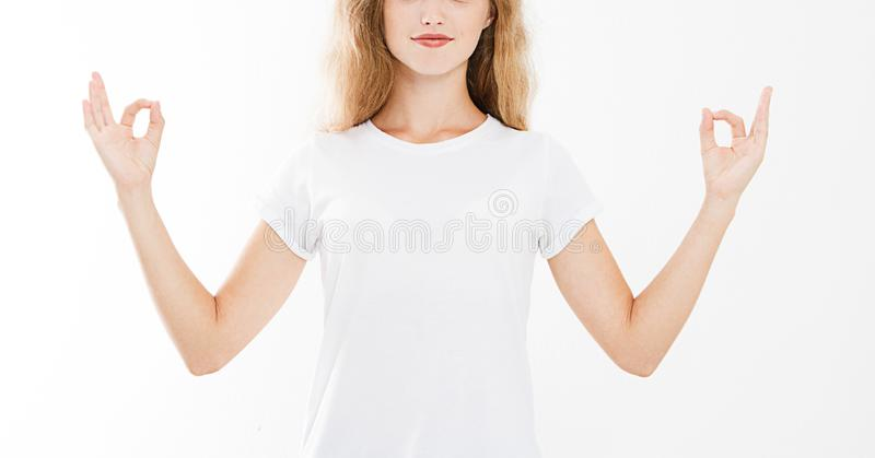 Close-up of hands of pretty woman, girl in t-shirt , meditating royalty free stock photos