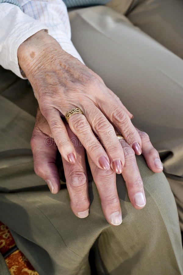 Download Close-up Hands Of Senior Couple Resting On Knee Stock Photo - Image: 14563654