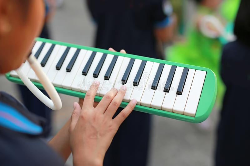 Close up hands of students playing melodian marching band the music you learned in high school stock photo