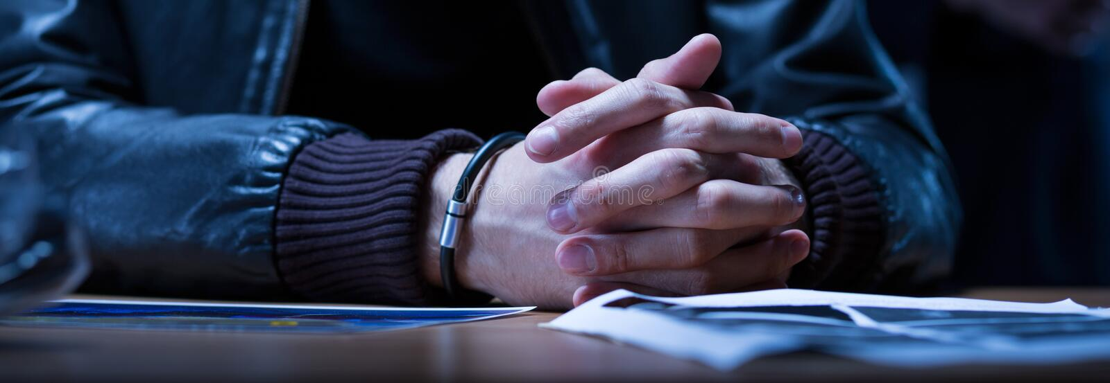 Close-up of hands of suspect royalty free stock photo
