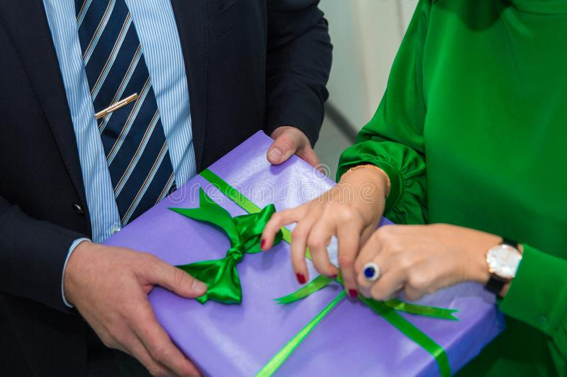 Close up hands woman and man open gift box at Christmas party, holiday celebration. Happy New year royalty free stock images