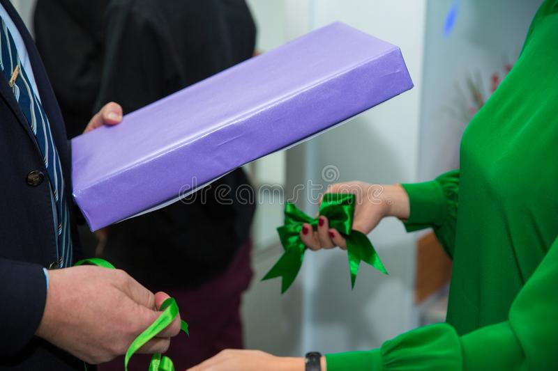 Close up hands woman and man open gift box at Christmas party, holiday celebration. Happy New year stock photos