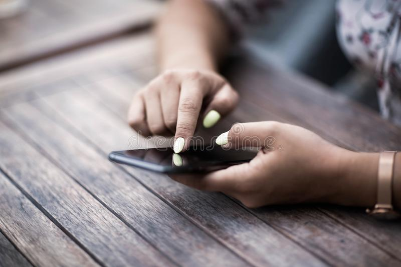 Close up of hands woman using her cell phone. Outdoor. royalty free stock photo