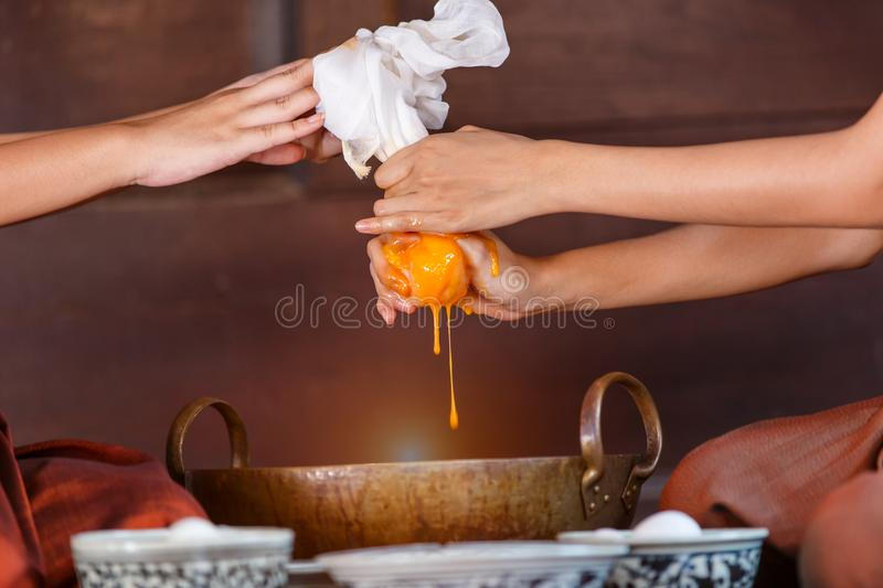 Close up hands women process dressed in ancient Thailand are helping to make the dessert of Thailand royalty free stock images