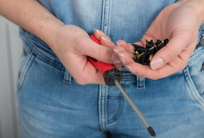 Close up of hands of young woman doing DIY work at home royalty free stock images