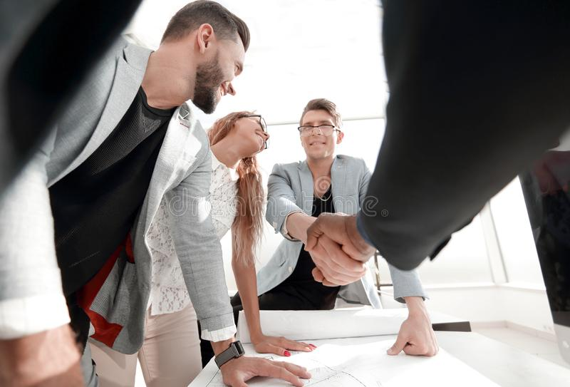Close up.handshake the architect and the client stock image